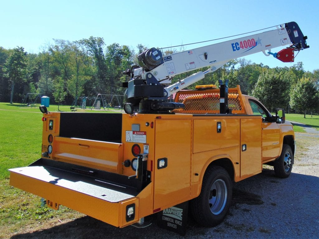 back of orange crane truck in park