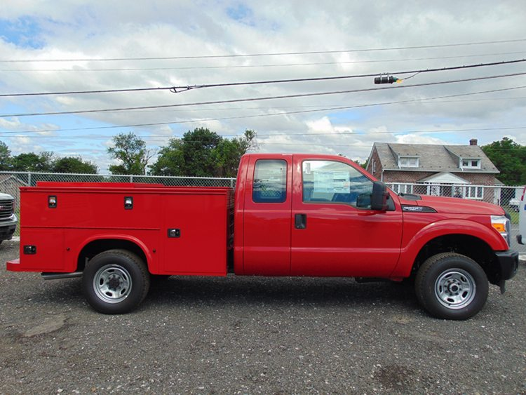 Red Utility Truck on asphalt road