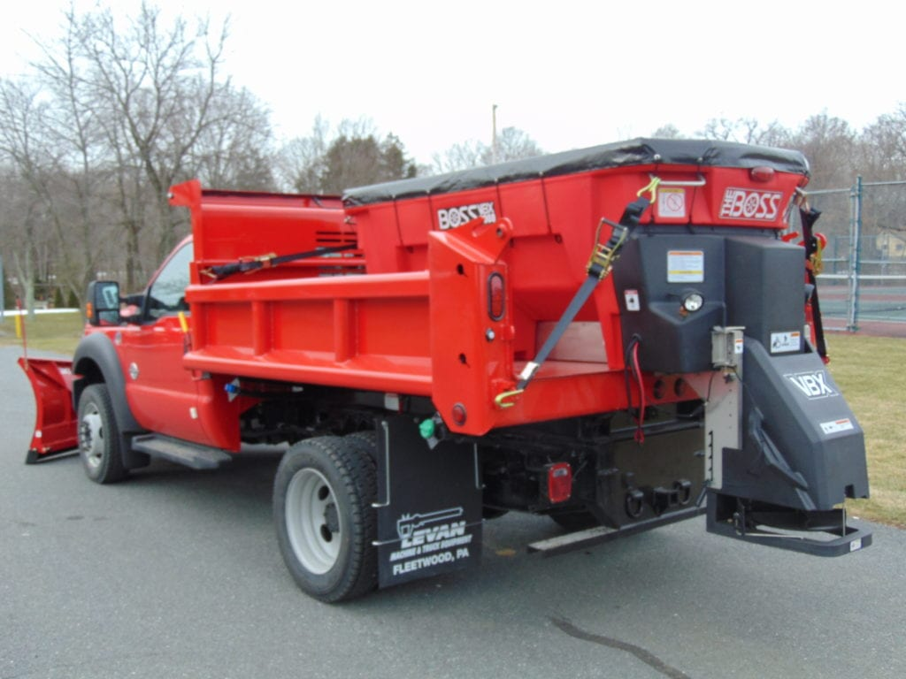 back of red dump truck with plow