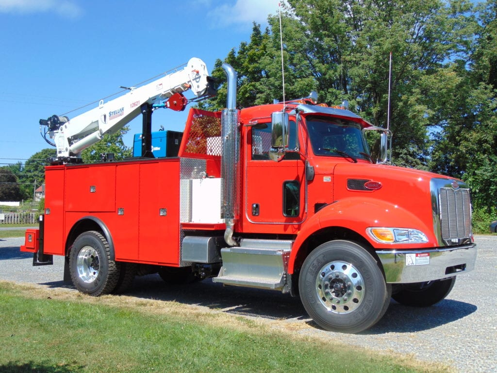 front of red and white crane truck