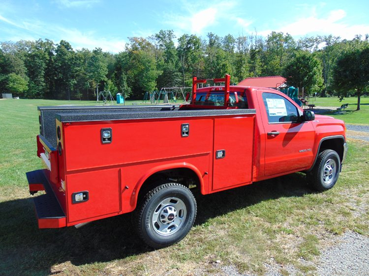 Red Utility truck on grass