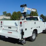 white work truck with crane