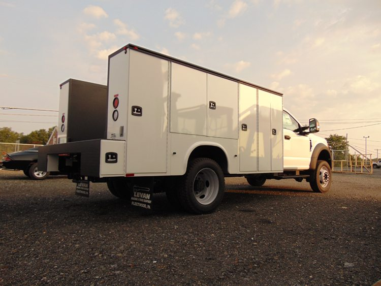 White utility truck with opentailgate