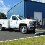 Boss brand snow plow in white truck
