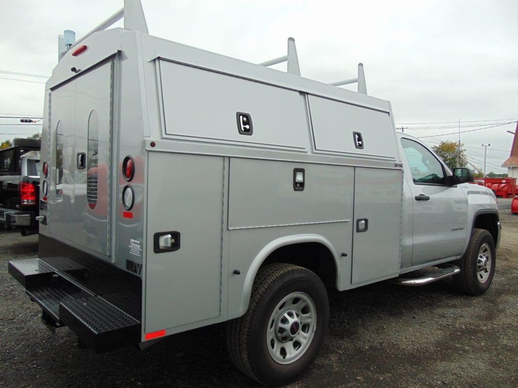 grey work truck parked in gravel