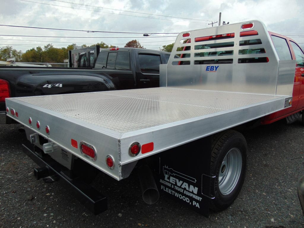 back of red and silver flatbed truck