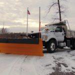 Henke snow plow on white truck