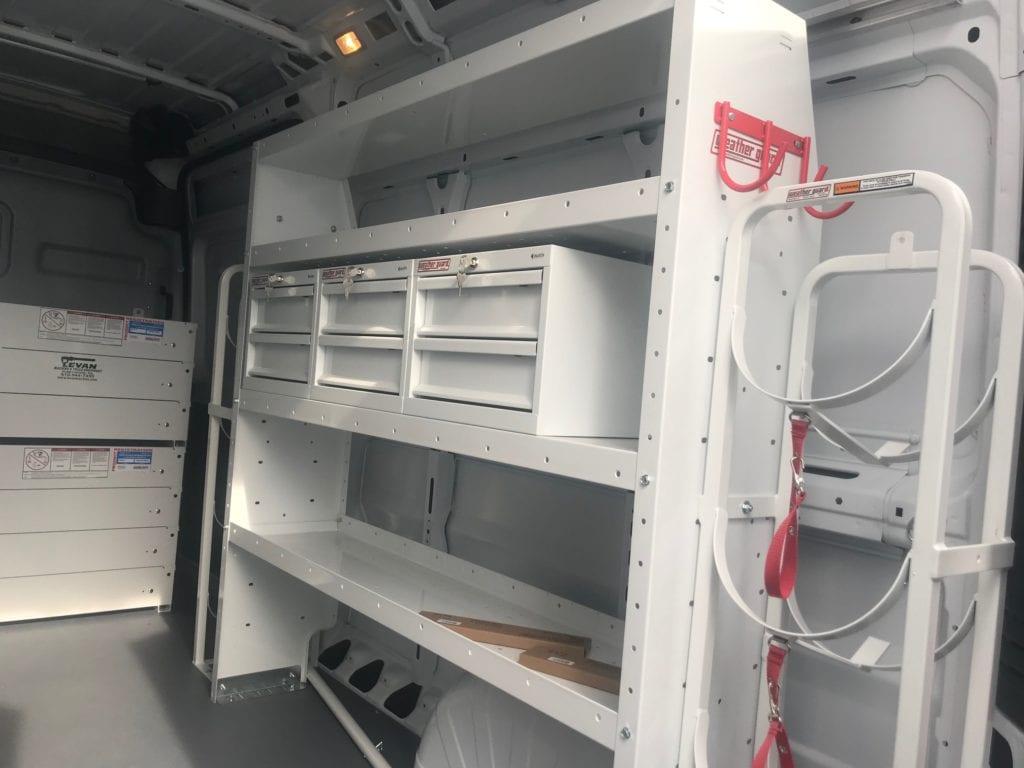 storage drawers in the back of a work van