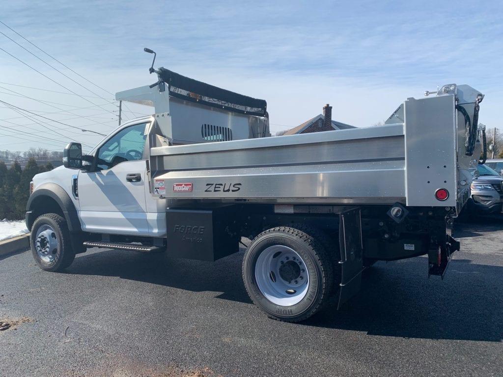 side of silver dump truck