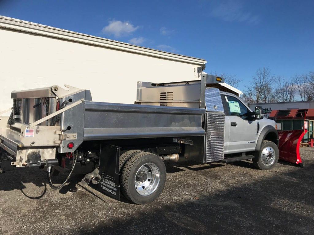 side of grey dump truck