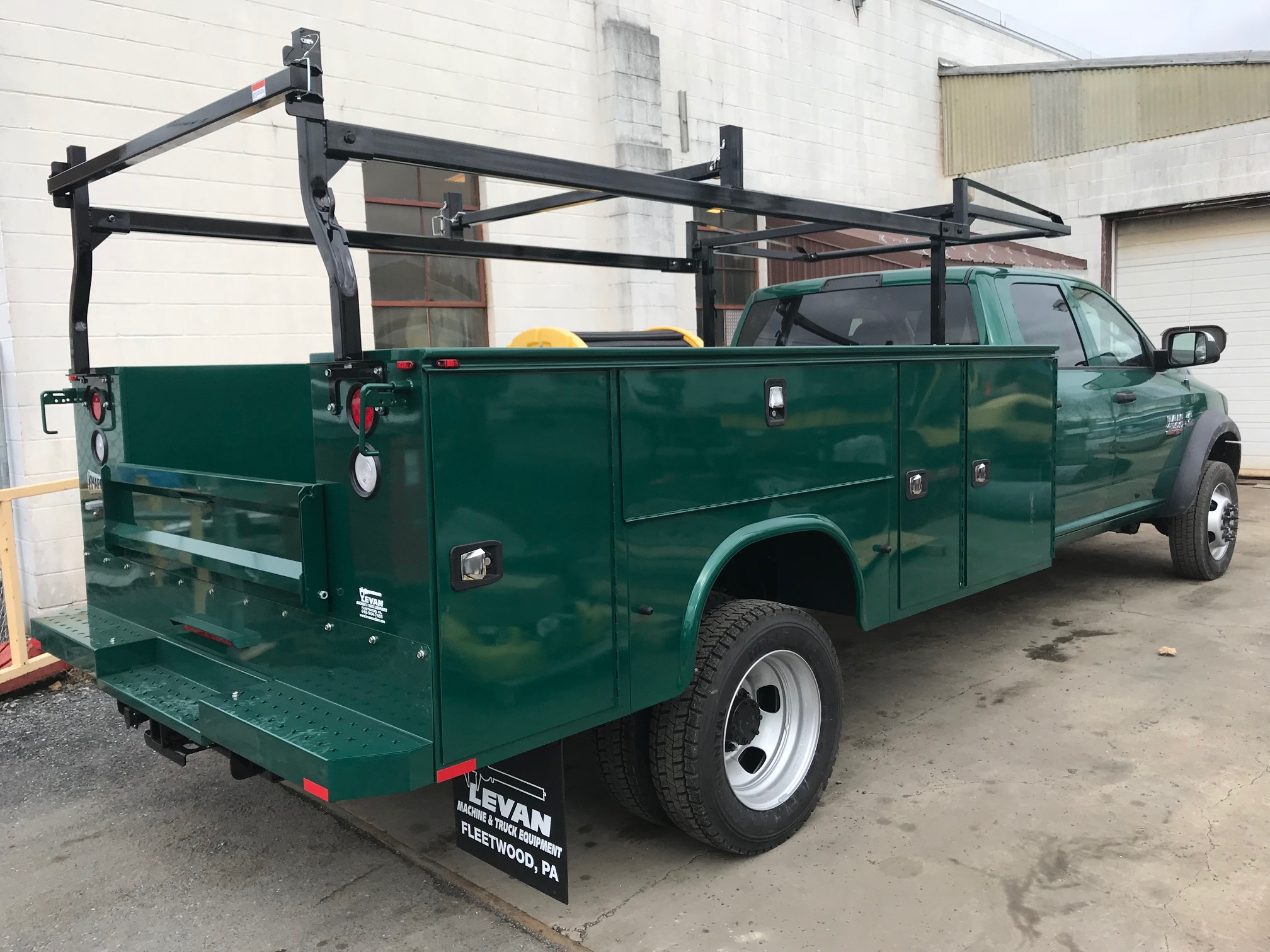 back of parked green work truck