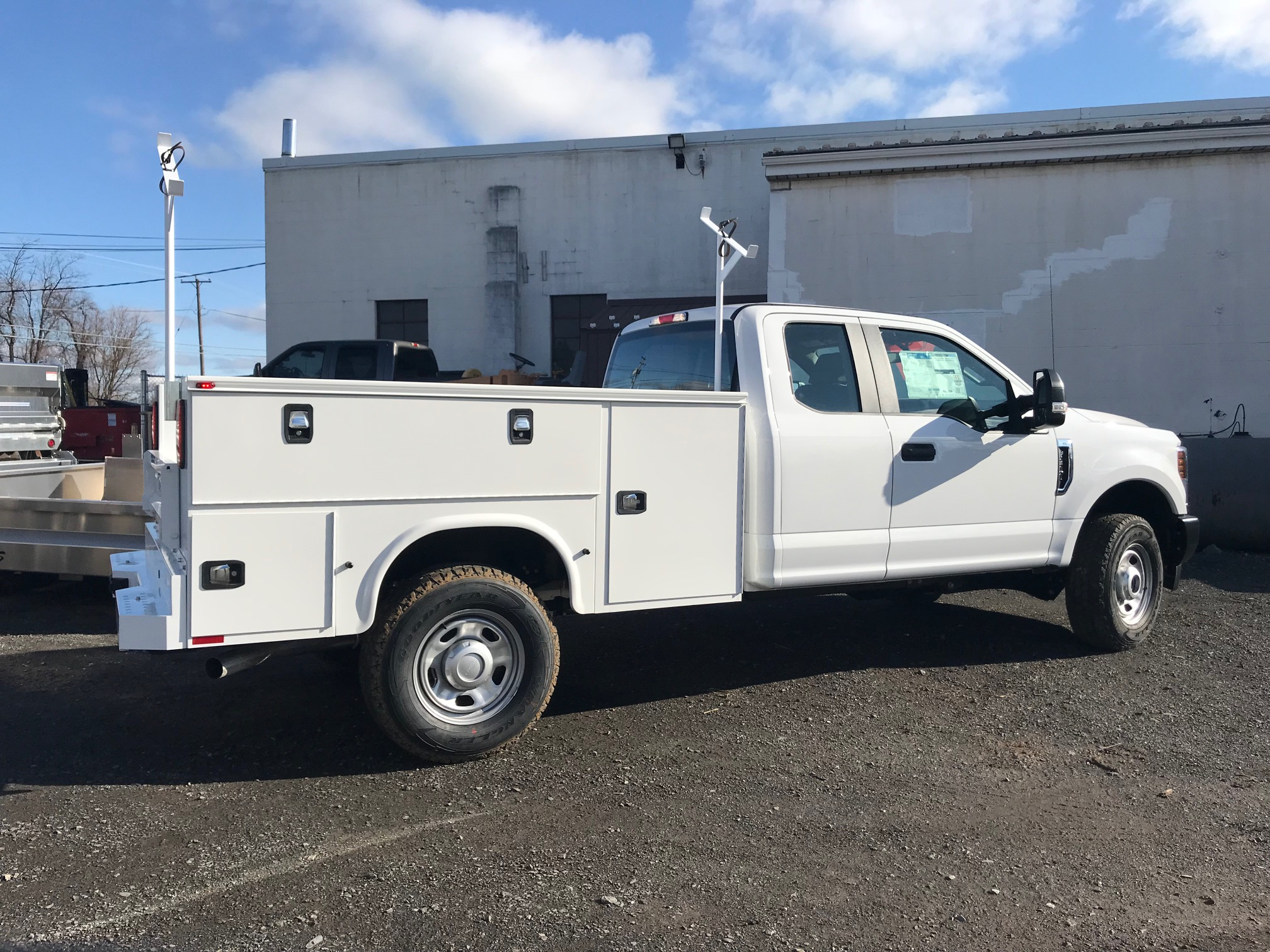 side of parked white work truck