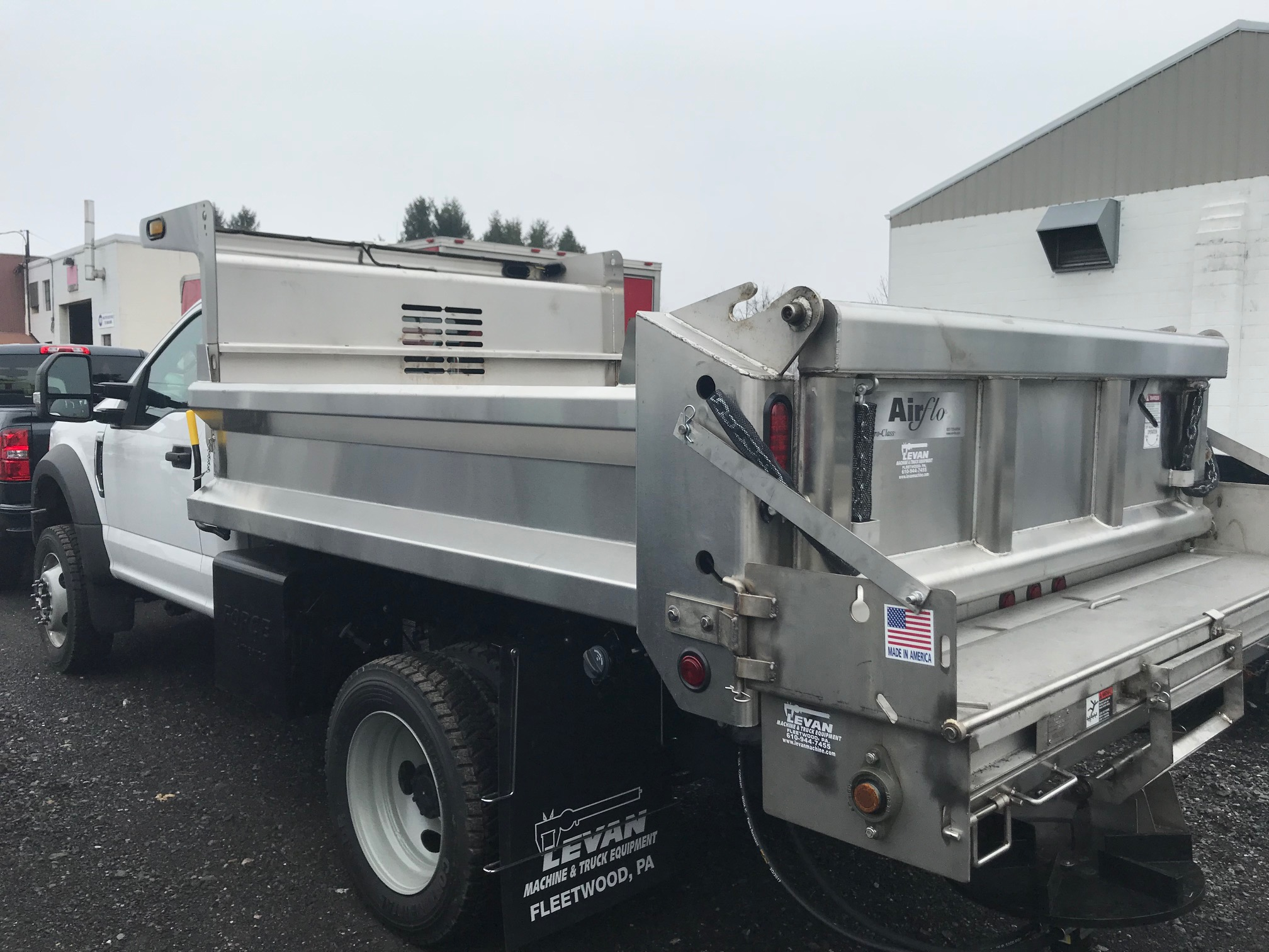 back of white and silver dump truck