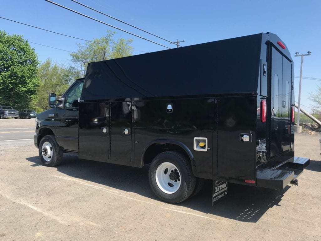 side of parked black work truck