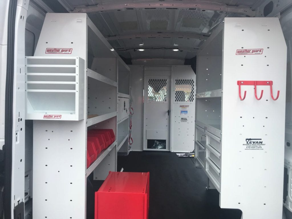 shelving in the back of a white work van
