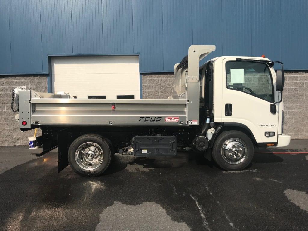 side of white dump truck