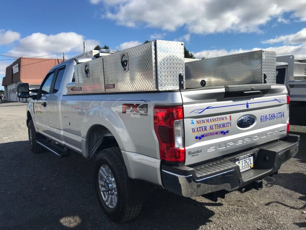 storage on the back of grey pickup truck