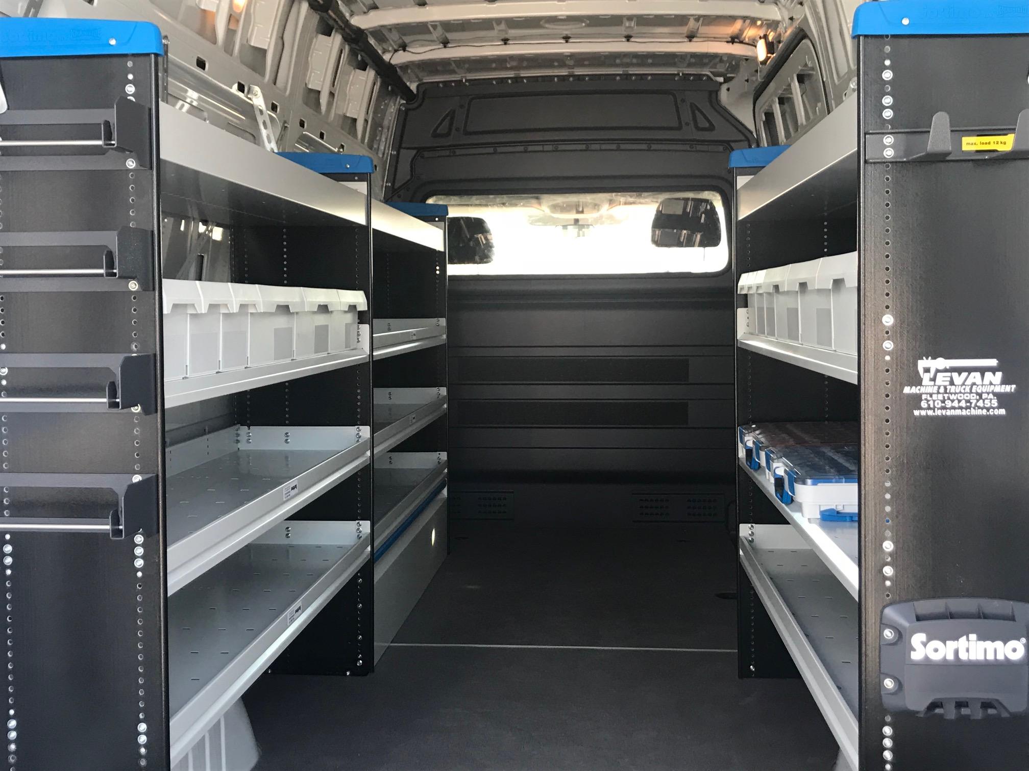 black shelving in the back of work van