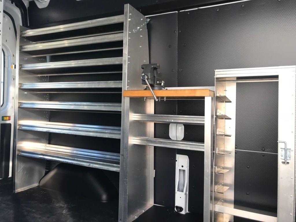 metal shelving in the back of work van