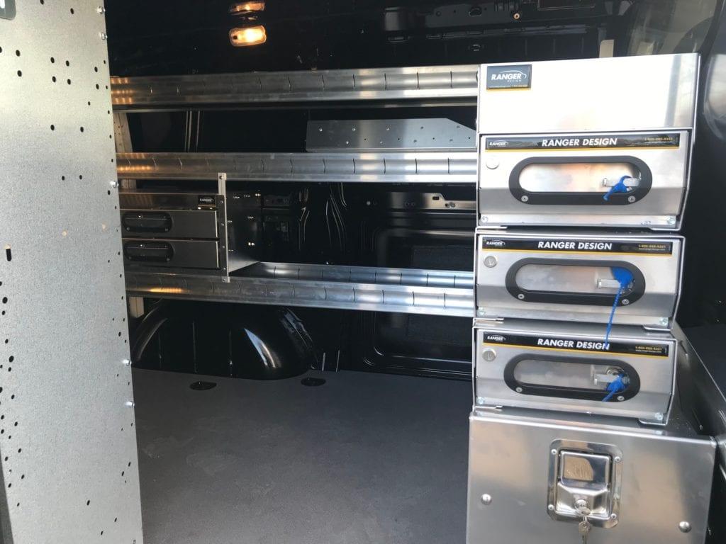 metal ranger design storage in the back of transit work van