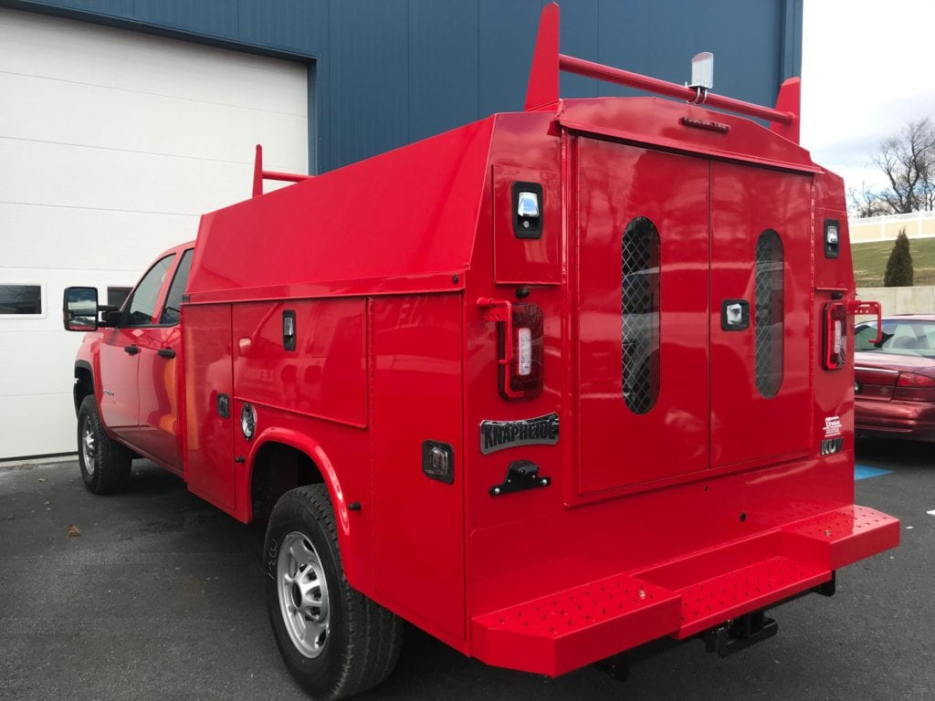 back of parked red work truck