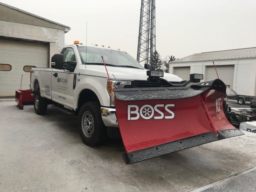 white pickup truck with red plow