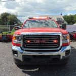 whelen lights on red service truck